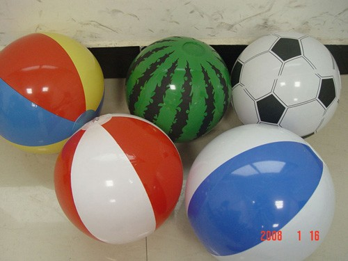 inflatable beach ball with bottle/toy inside