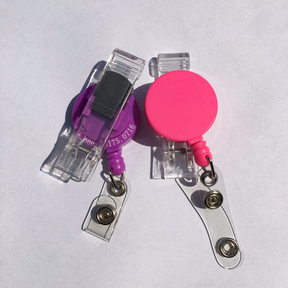 Round badge reel with plastic swival clip