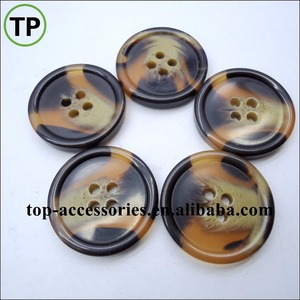 Classic plastic/resin tortoise shell button with four holes for coat