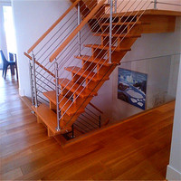 Indoor stainless steel round rod ballustrade and wooden steps stair case