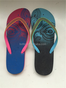 35344e2af12a China cheap Ladies flip flops Rubber sole material special Strap design