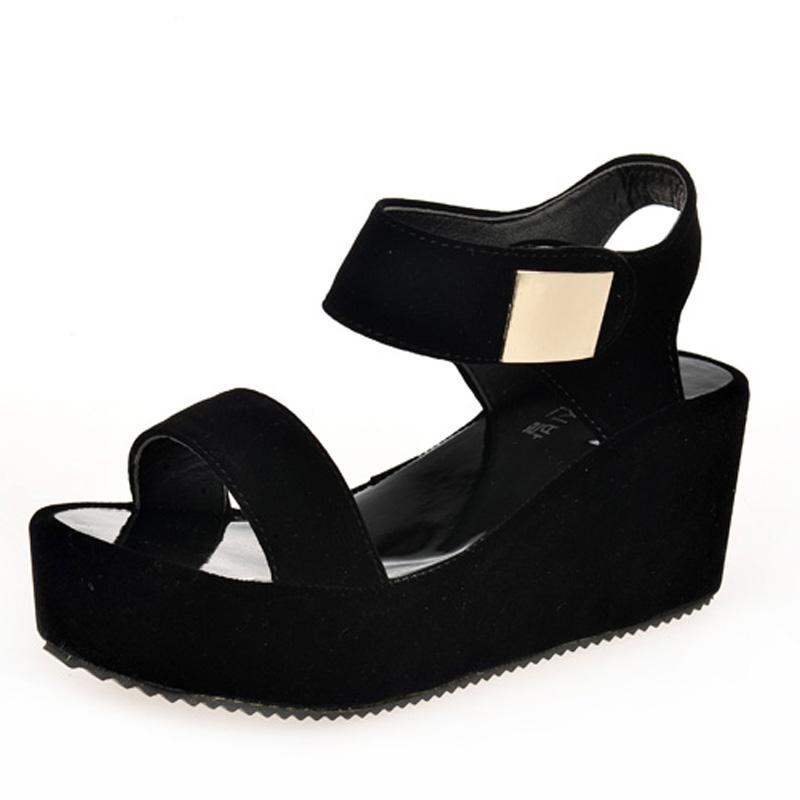 black wedge heel pumps