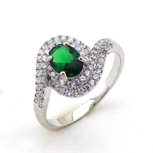 Ladies Swirl Sterling Silver Simulated Oval Emerald Halo Ring