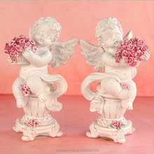Wholesale custom small angel figurines with flowers