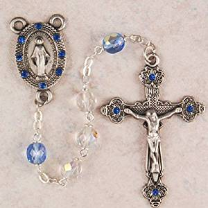 Light Blue and Crystal Glass Catholic Rosary Beads - This Elegant Rosary has 7mm Blue and Crystal Aurora Borealis Glass Rosary Beads and a New England Pewter Crucifix and Miraculous Medal Centerpiece with Gorgeous Blue Austrian Stones on the Crucifix and Centerpiece. The Rosary comes packaged in a