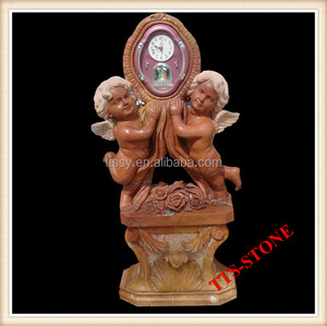 red marble carved clock with angel statue