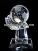 clear crystal globe ball on hand trophy