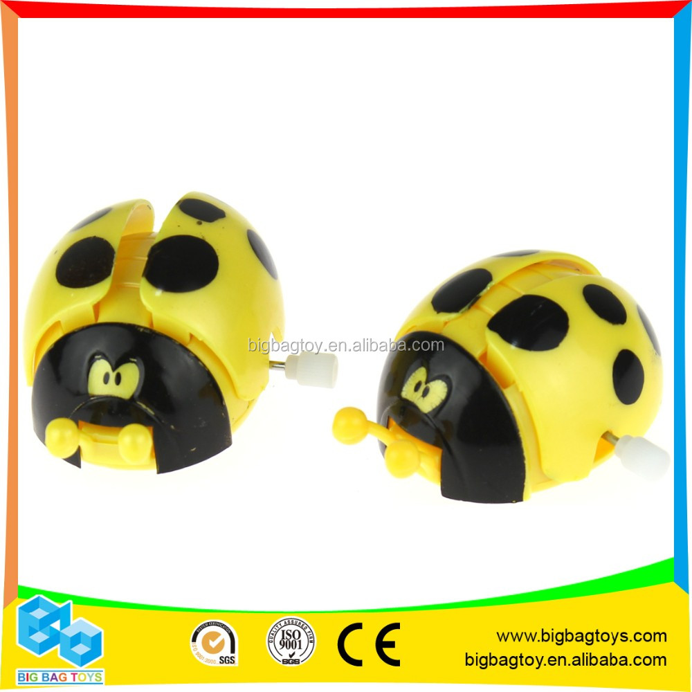 cheaper yellow wind up toy mechanism beetle for kids