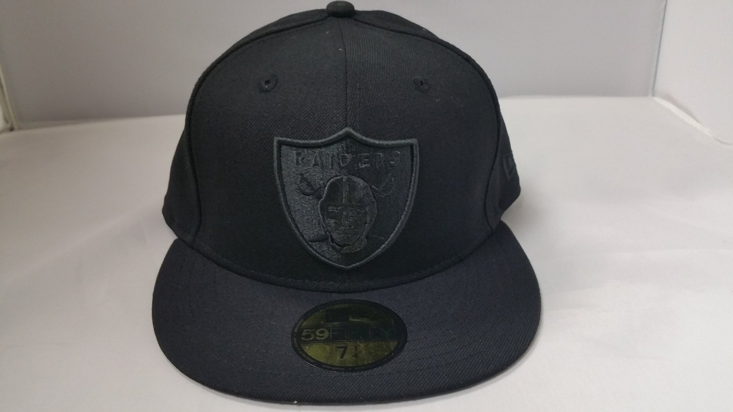 8e0b82caaa0 Get Quotations · New Era NFL Oakland Raiders All Black Shield Logo Fitted  Cap 59Fifty NewEra