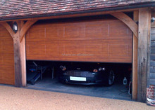 Automatic light walnut sectional garage door