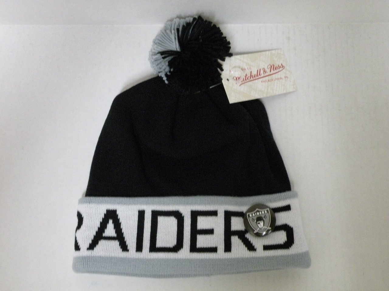 e6ea8aa6df6 Get Quotations · Mitchell and Ness NFL Oakland Raiders 2 Tone Cuffed Knit  Pom Beanie Cap with Pin