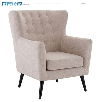 highbacked design with button detailing and wooden legs armchair wingback tufted chair