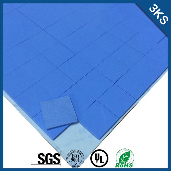 solid silicone thermally conductive insulator with single sided adhesive