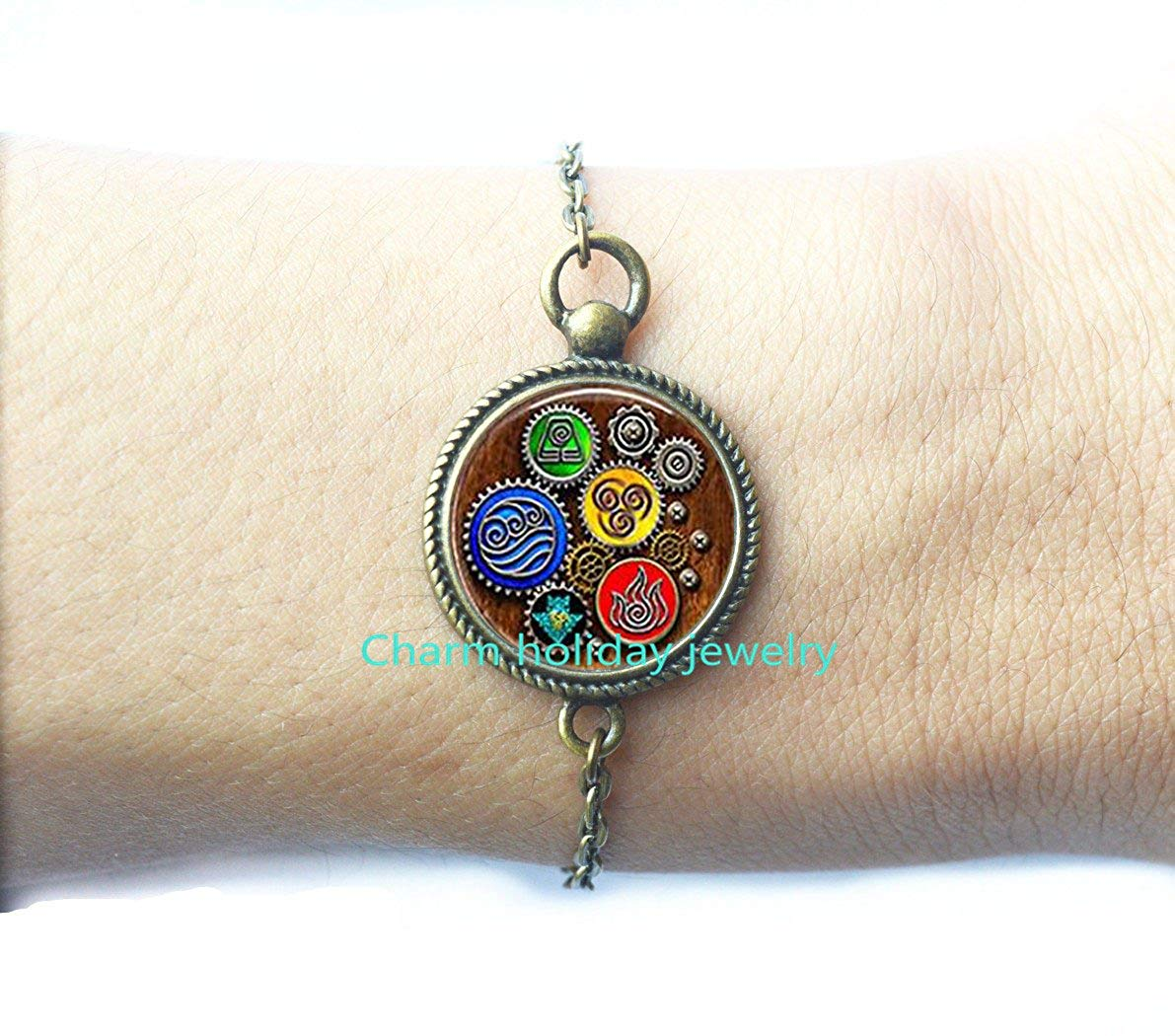 DiamondJewelryNY Eye Hook Bangle Bracelet with a Guardian Angel Charm.