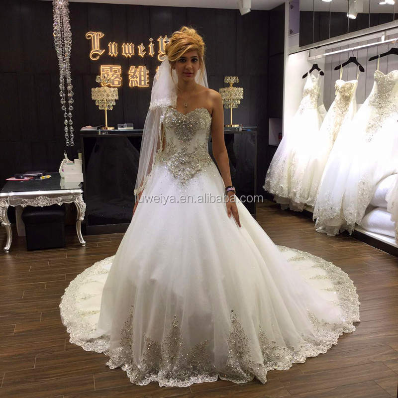 Gorgeous Crystal Wedding Dresses 2015 Ivory Bridal Dress Beaded Bow Tulle Long Train