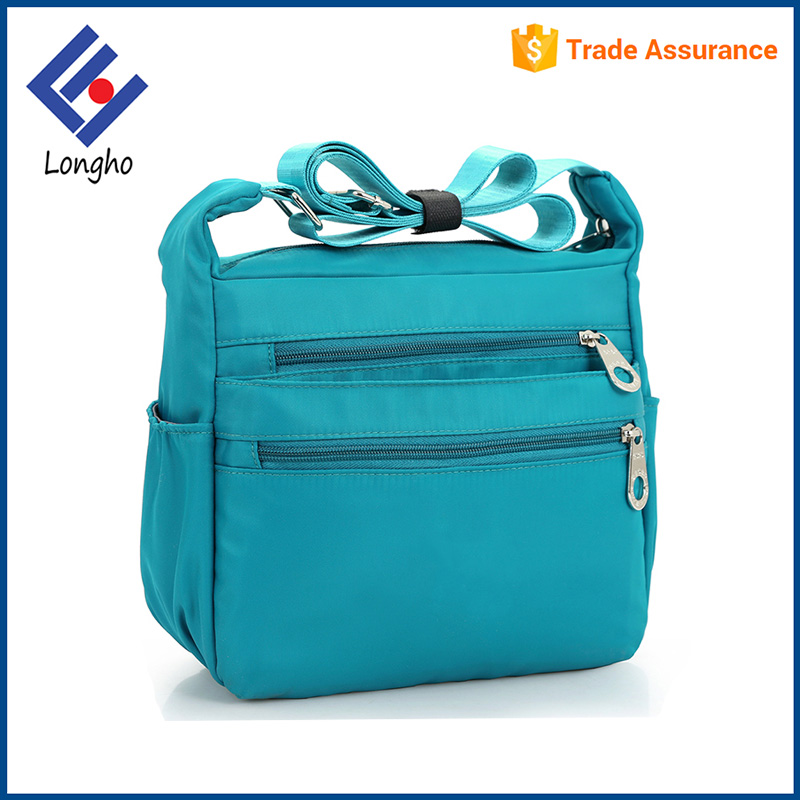Simple style girls satchel bag with bottle holder water resistant nylon wholesale cross body bags women