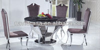 Wrought iron dining table with marble top