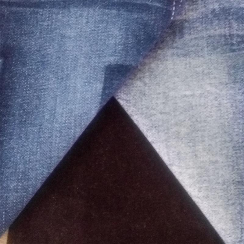 Colored rolls of dark blue woven bamboo cotton/spandex denim fabric