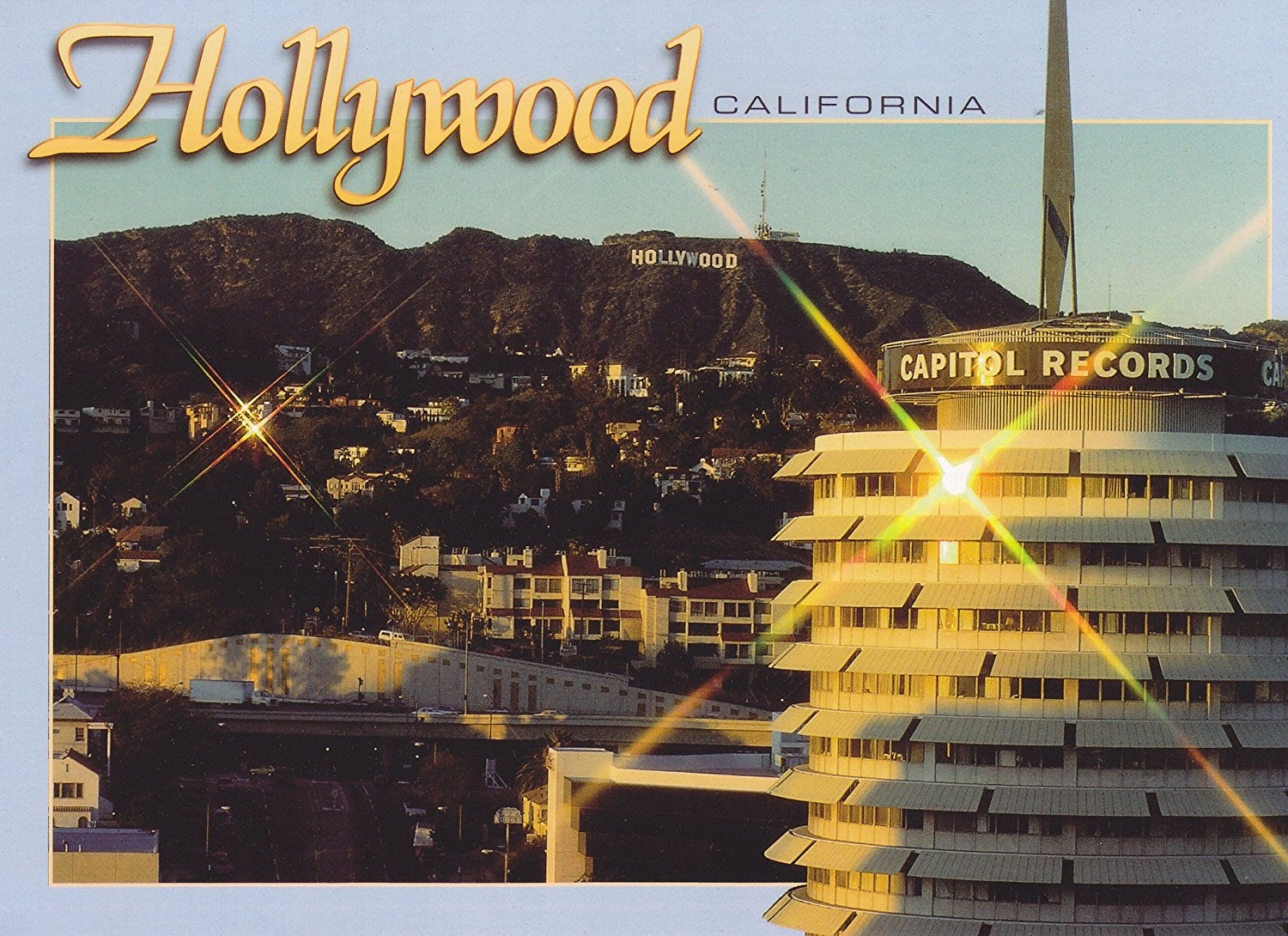 "TRKLA227 LA-227 HOLLYWOOD, CALIFORNIA, The sun begins to set over Hollywood and glimmers off the Capitol Records Building .. .. - [[ 7"" x 5"" POSTCARD ]].. From Hibiscus Express"