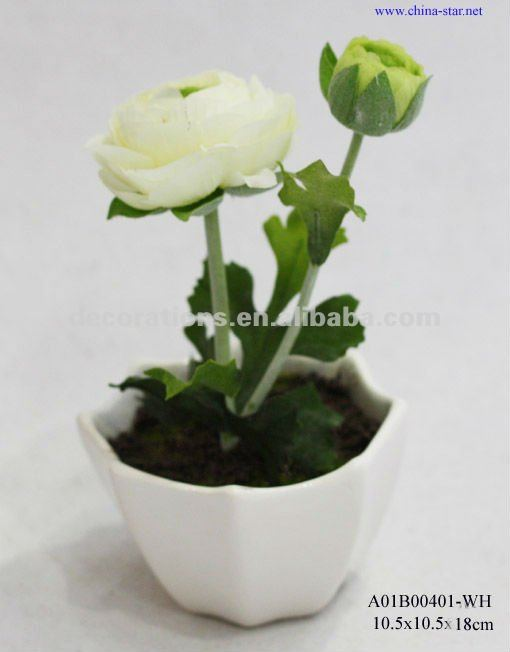 artificial white ranunculus in ceramic planters