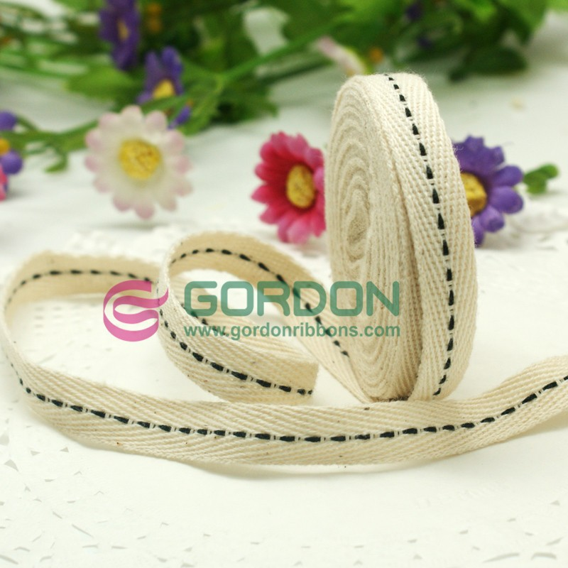 off white cotton ribbon with black stiched in the middle