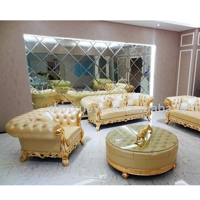 Chesterfield golden color leather sofa seat with round center table ...