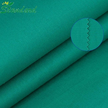 Wholesale price plain dyed 100% cotton twill shirt fabric