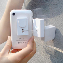 Retractable cable security display stand for mobile phone