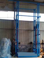 China 1000kg hydraulic warehouse used goods lift electric fixed freight cargo elevator