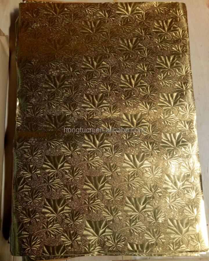 Hot sale factory price silver& gold embossed aluminum foil laminated paper for cake board