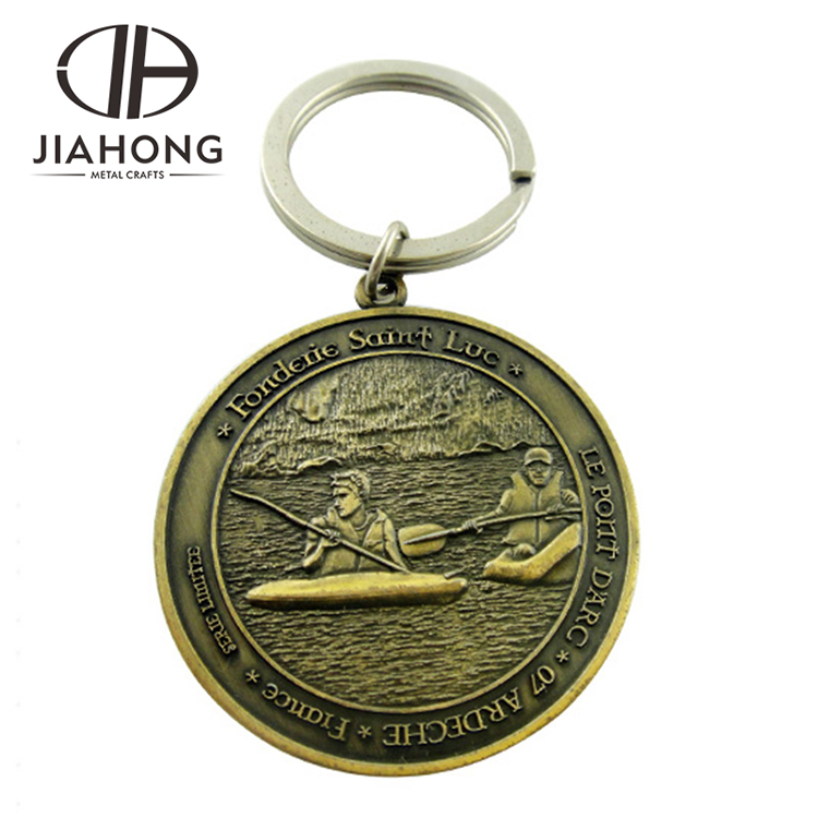 custom brass religious tourist compass metal keychain with embossed carvings