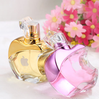 fancy 25ml 50ml 100ml apple shape glass perfume bottle for sale