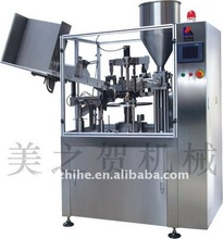 Plastic tube filling and sealing machine
