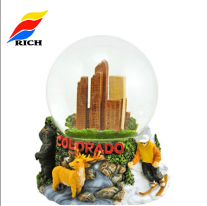 Cheap custom christmas 80mm resin snow globe souvenir