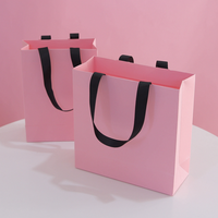 Wholesale China Supplier Custom Logo Pink Paper Bag Garment Storage Shopping Carrying Bag for Apparel High Quality Retail Bag