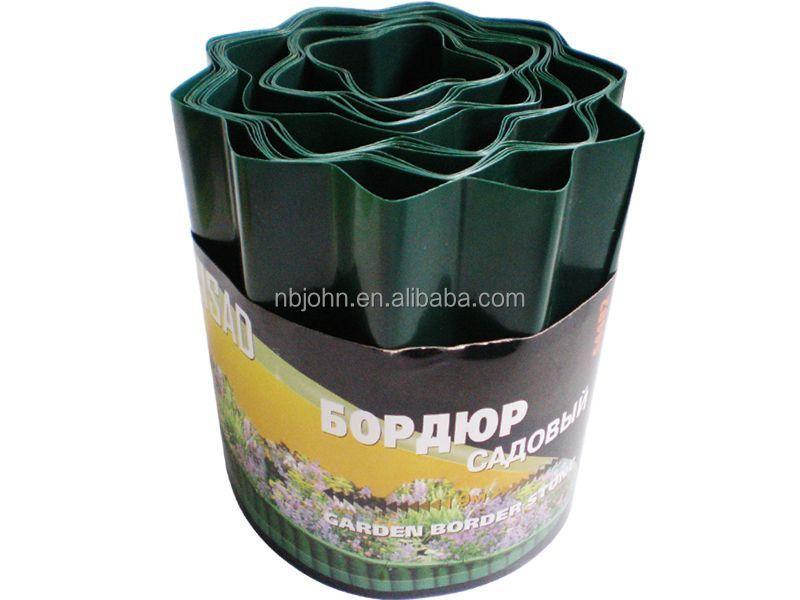 Borde cerca del jard n de c sped de pl stico vallado for Borde plastico para jardin