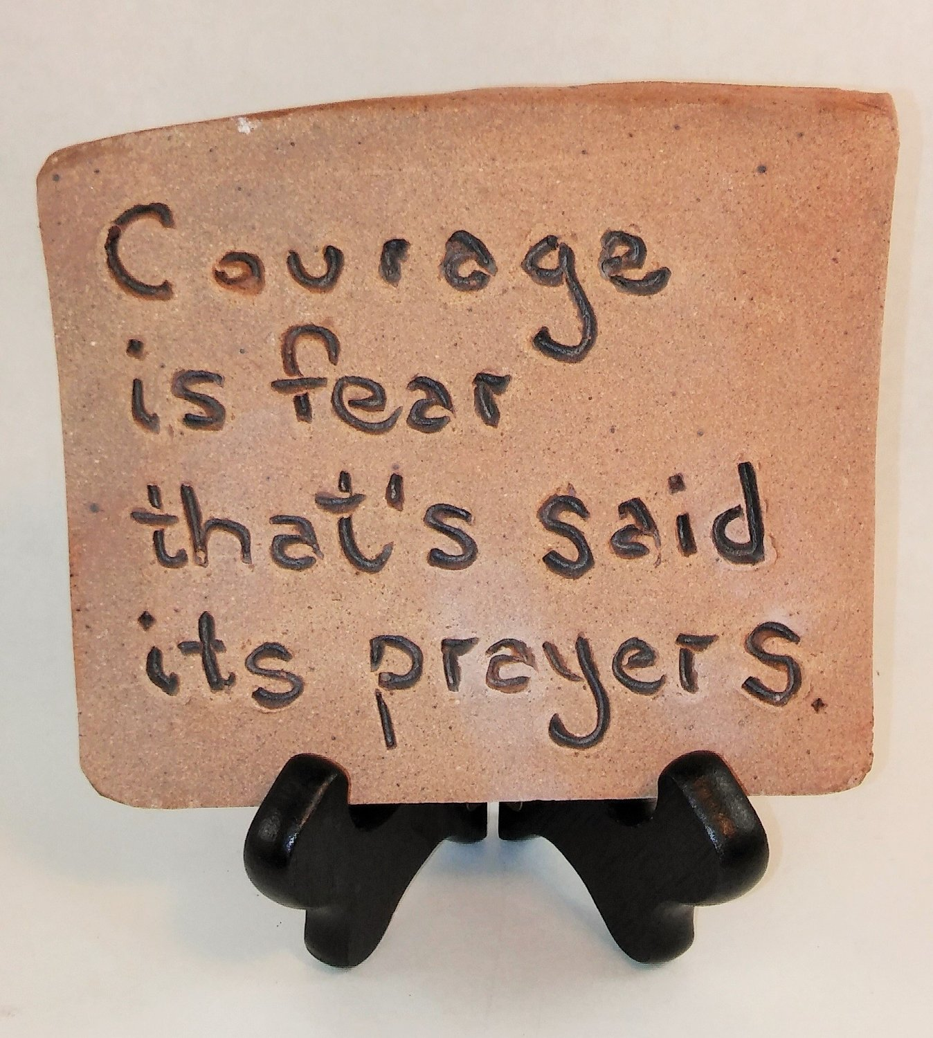 "Aunt Chris' Pottery - Desk Top - Rustic Clay Sign - With Unique Biblical Words Or Quotes ""Courage is fear that's said its prayers."" - Sits On Wood Easel"