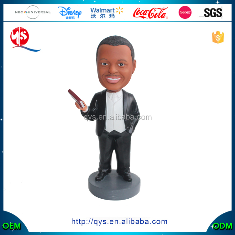 Resin figure bobble head of a man with book in his hand
