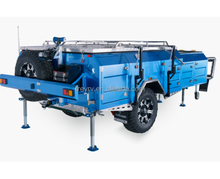 Forward fold off-road camper trailer with tool box