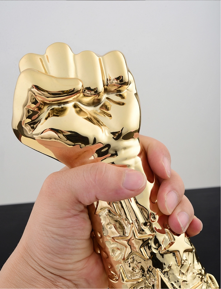 custom cheap metal creative fist shape crystal trophy with black base