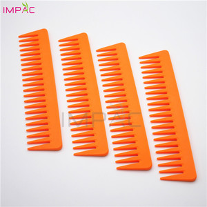 Soft touch common use stretch orange plastic wide tooth hair comb