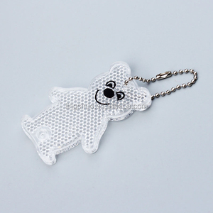 2018 news EN 13356 Custom PMMA plastic bear shape reflective keychain for promotional gifts