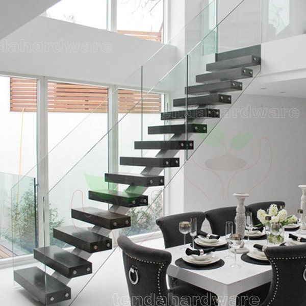 centre spine type stair with walnut treads and glass