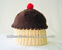 Creative hand knitted cake pattern lovely hat for baby wearing