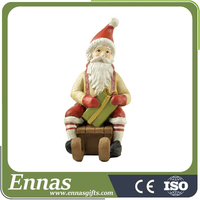 Polyresin good christmas gift of santa on sled for decoration