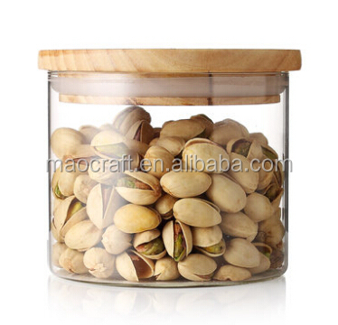Clear glass canister with bamboo lid, wood lid, colored tin lid