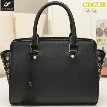 2015 New Arrivals Women s hand bag Hole retro metal rivets single shoulder  bag Hole handbags 975f16faa29e6