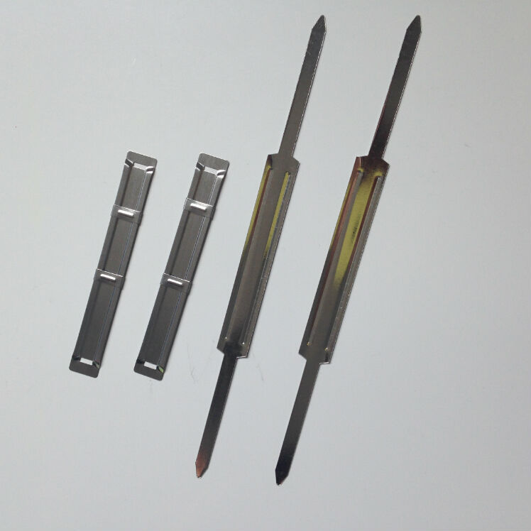 paper fastener A staple (from which the paper fastener was developed) a staple is a type of two-pronged fastener, usually metal, used for joining or binding materials together.