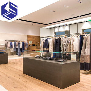 Modern clothing store display design metal clothing rack glass clothing shop counter