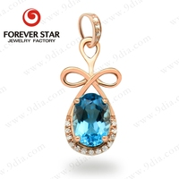 Alibaba wholesale women's pendant design 7*5mm cabochon blue topaz 14k pure gold jewelry